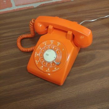 vintage orange rotary phone Film prop rental NY